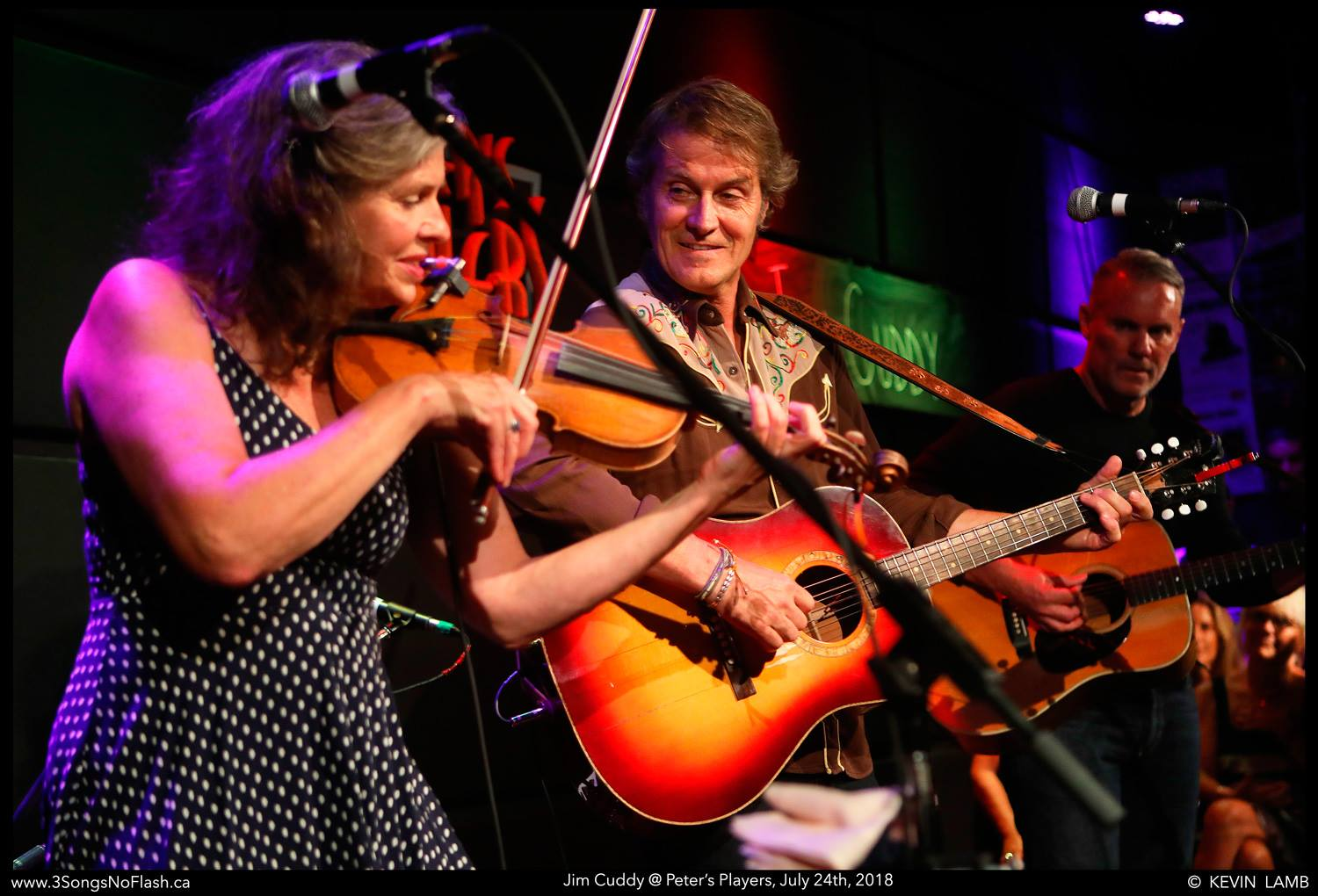 Peters Players fiddler and guitarist on stage